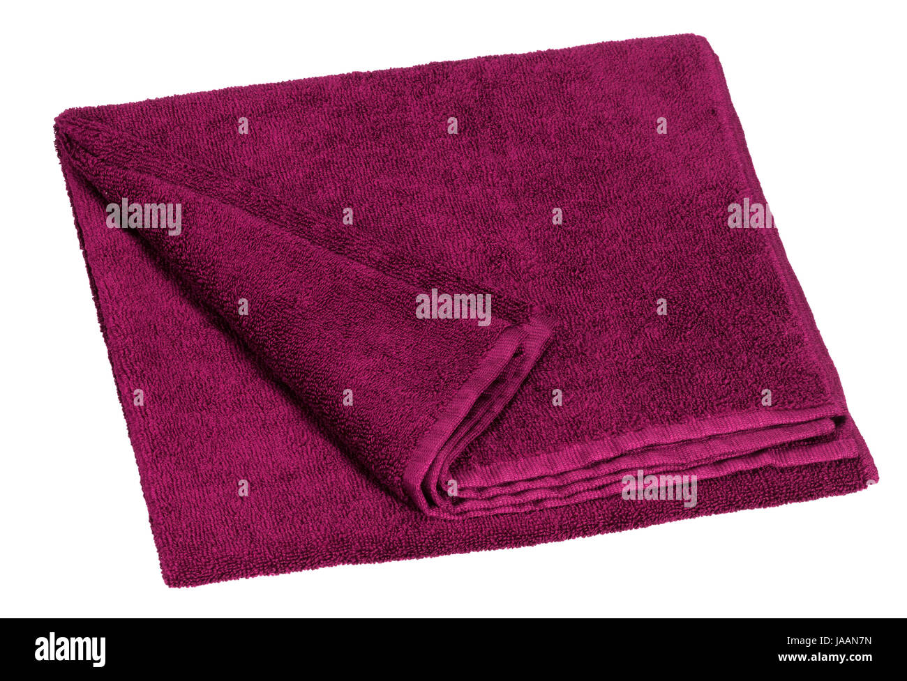 a violet towel in white back - Stock Image