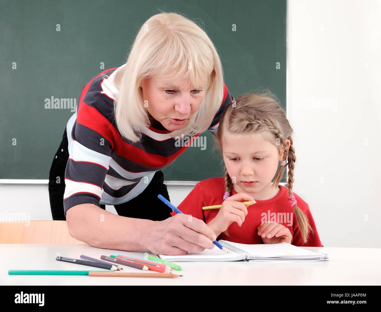 Ältere Lehrerin, alt, älter, Lehrerin, Lehrer, Schülerin, Schüler, Schule, Unterricht, Beruf, Hochschule, Universität, Stock Photo