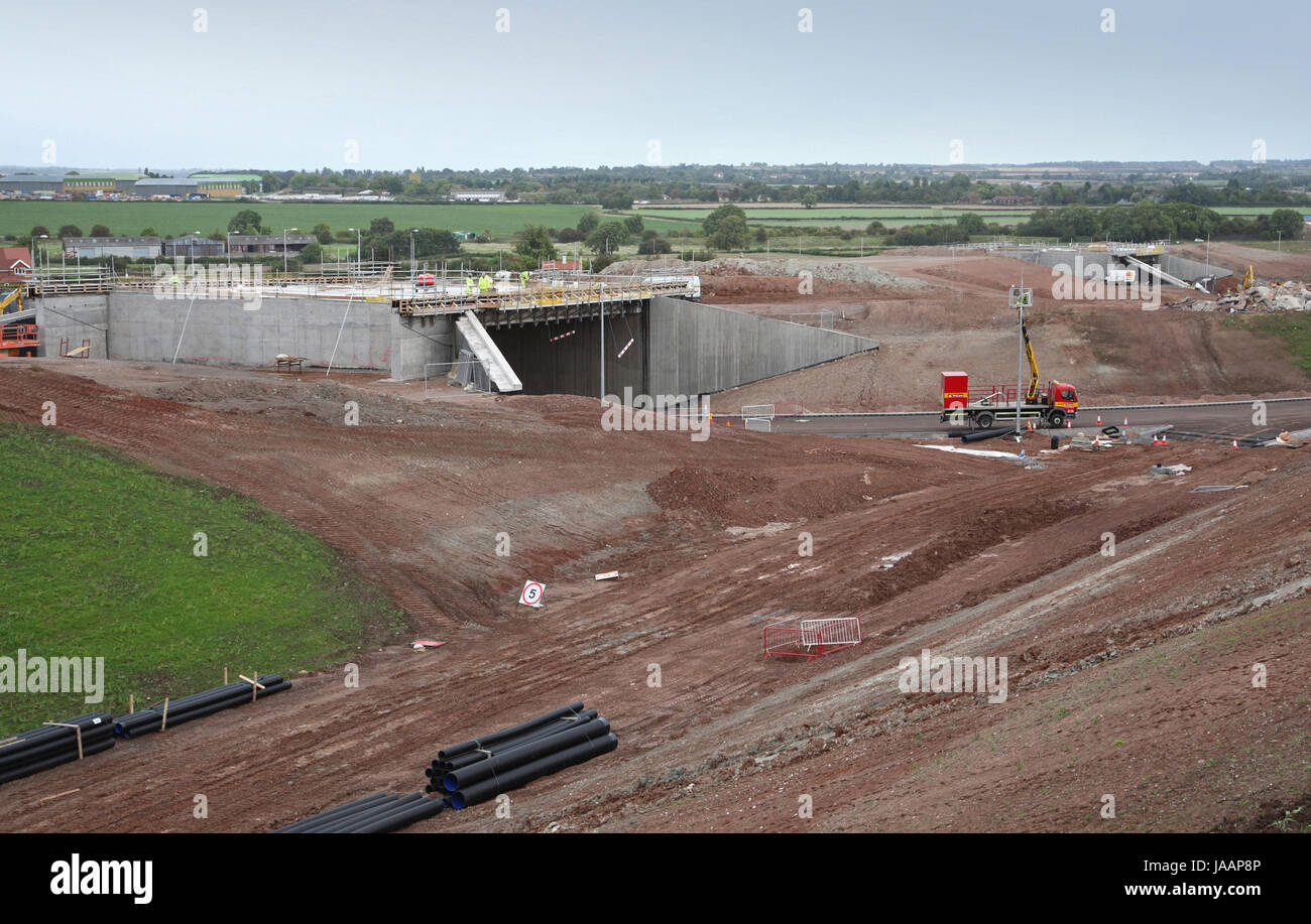 Construction of a new section of dual-carriageway on England's A46 trunk road. Shows new flyovers and roundabout - Stock Image