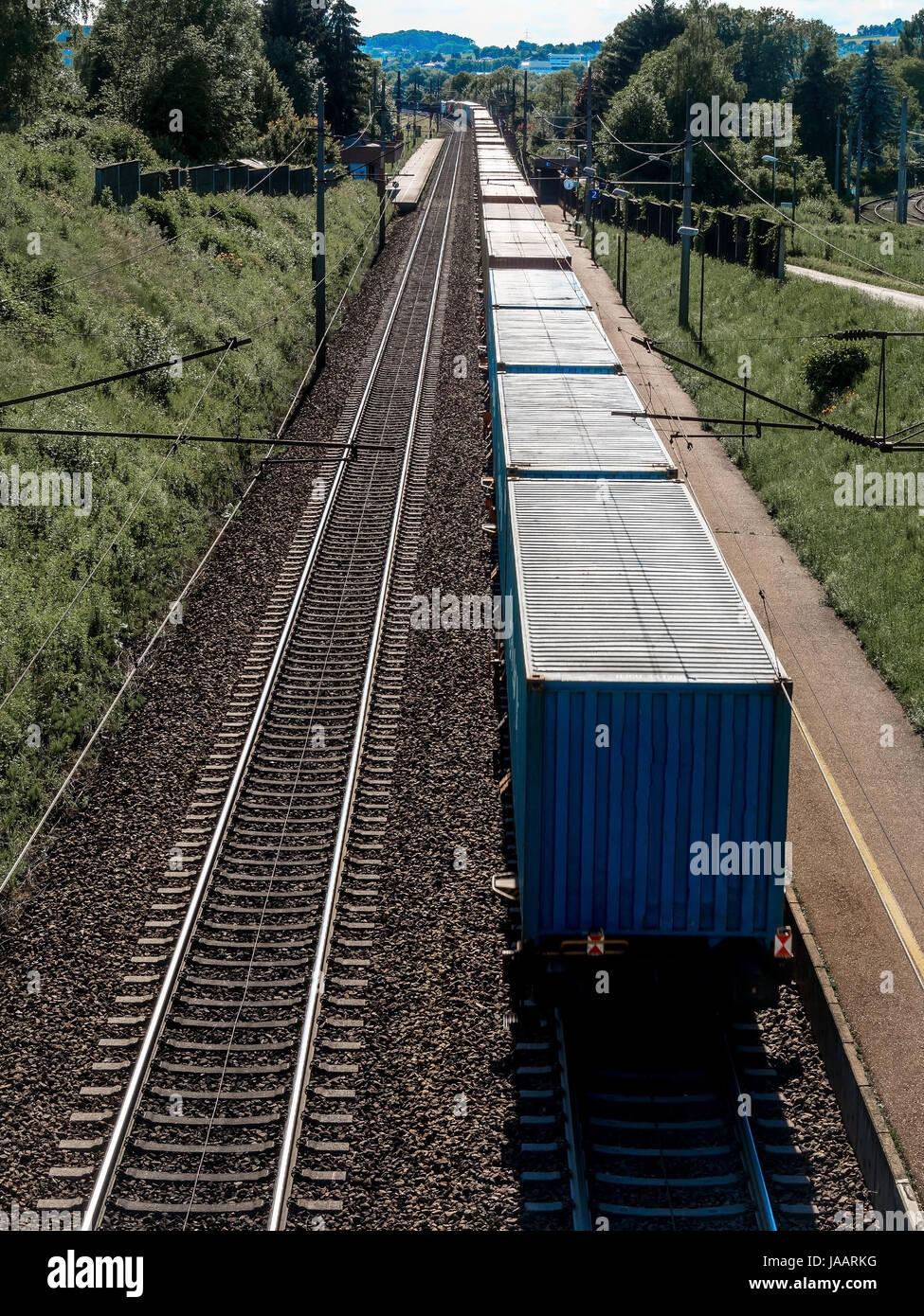 A train with goods on a section, Ein Zug mit Gütern auf einer Bahnstrecke Stock Photo