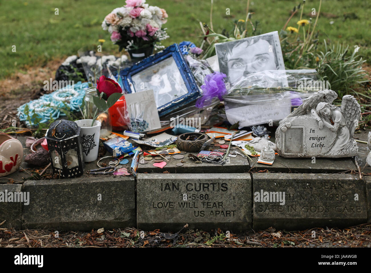 Ian Curtis' memorial stone at  Macclesfield Crematorium in Macclesfield, Cheshire, UK. The English singer-songwriter - Stock Image
