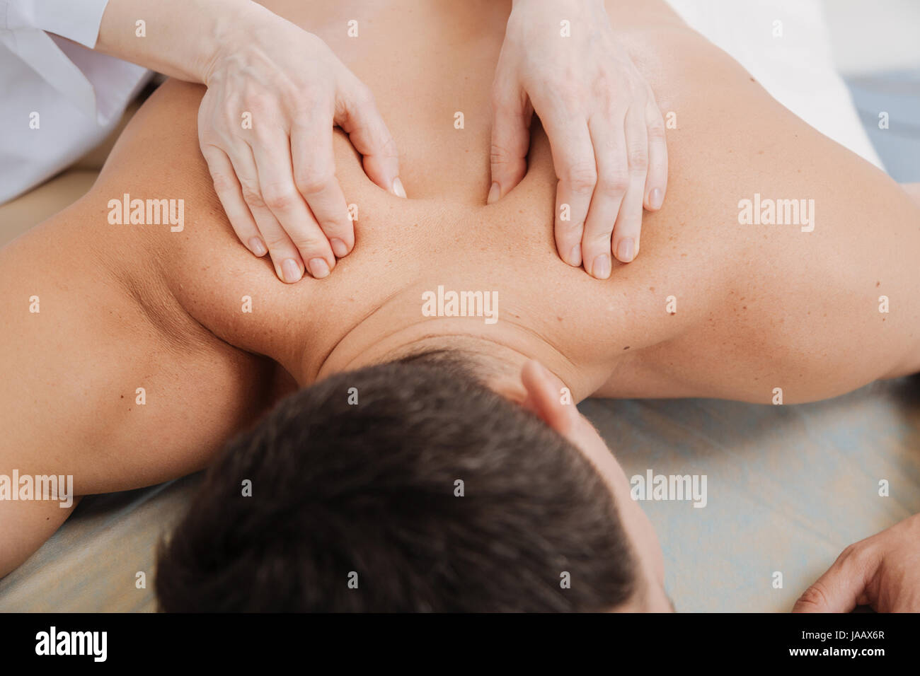 Touch therapy. Wonderful trained local expert using her skills for relieving the pain her patient experiencing after - Stock Image