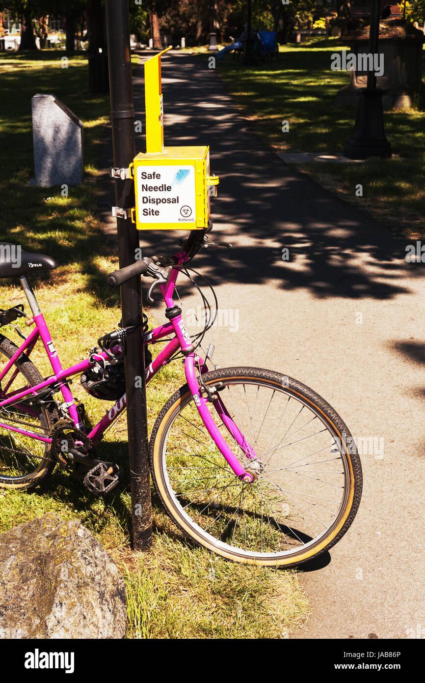 Safe needle disposal site. Victoria British Columbia Canada - Stock Image