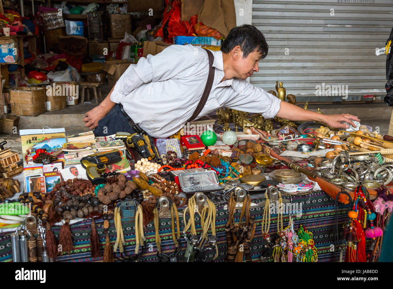 Yangshuo, China.  Vendor of Assorted Souvenirs, Gifts, Bracelets, and Sundry Items. Stock Photo