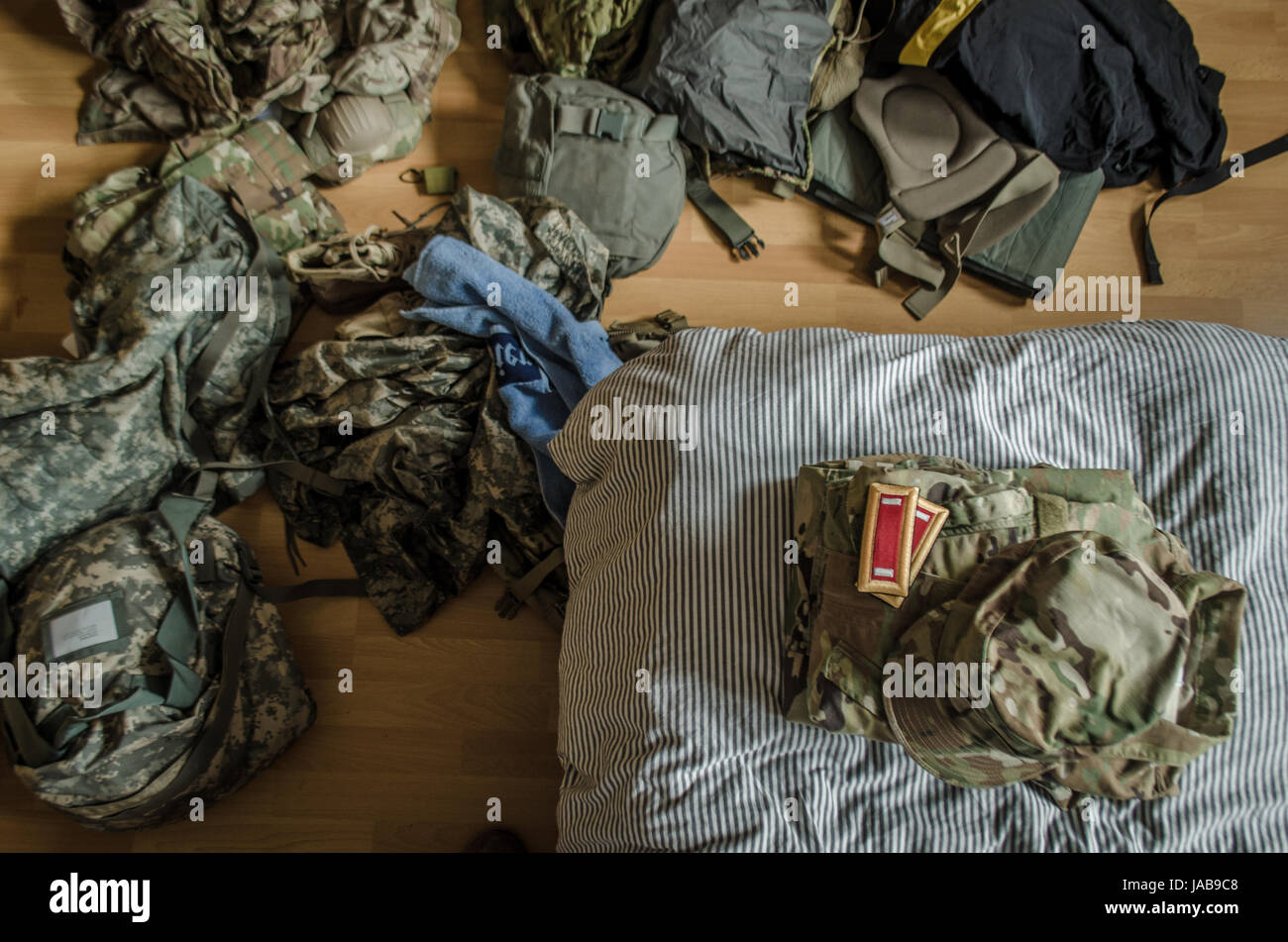 US military uniform scattered on a bedroom floor Stock Photo