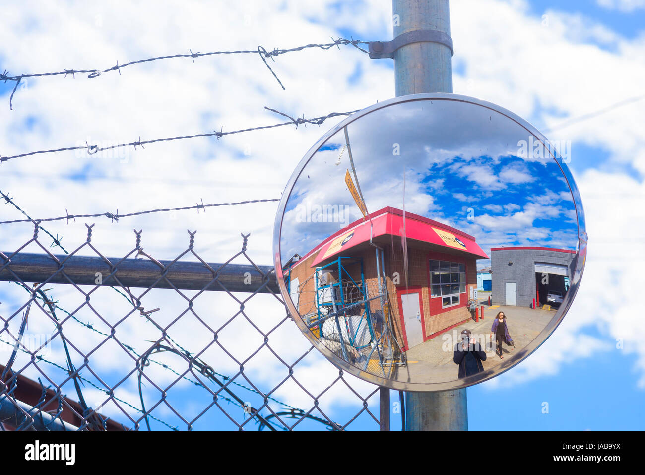 convex mirror in parking lot - Stock Image