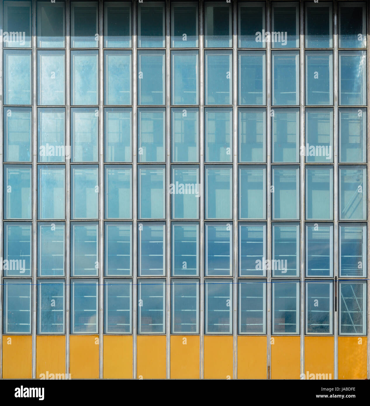 Architecture abstract background. Glass curtain wall texture. Stained-glass system based on outdated technology. Stock Photo