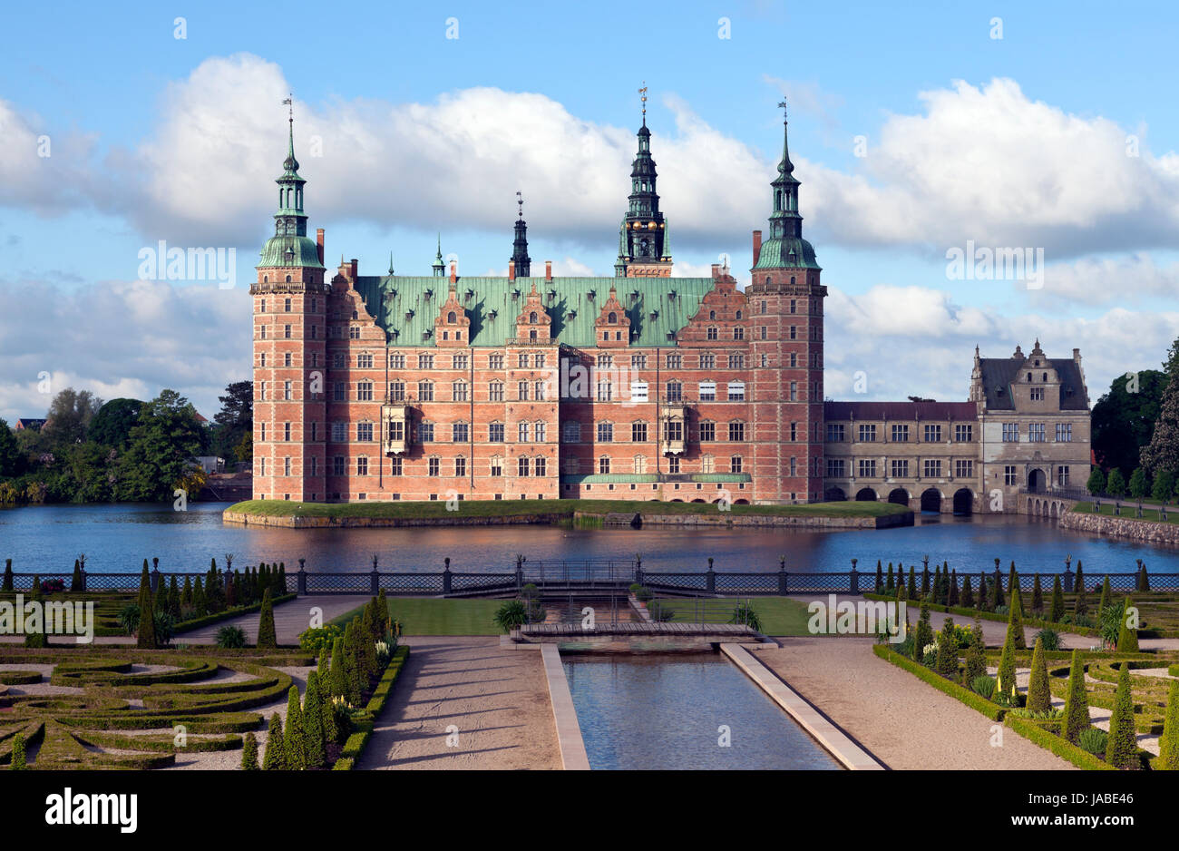 Frederiksborg Castle in Dutch Renaissance style and the Baroque Garden. Hillerød near Copenhagen. Morning sun, - Stock Image