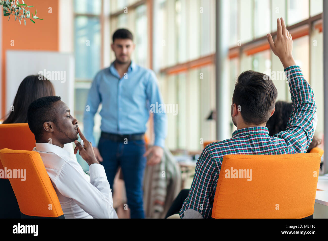 business, startup, presentation, strategy and people concept - man making presentation to creative team at office - Stock Image