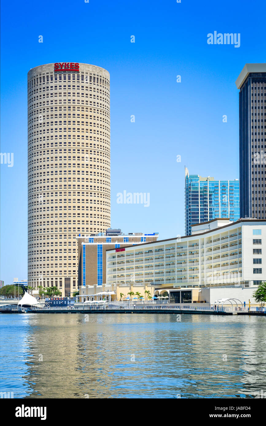 Tampa River Walk pedestrian pathway winds alongside the Rivergate building in the arts district & the Sheraton - Stock Image