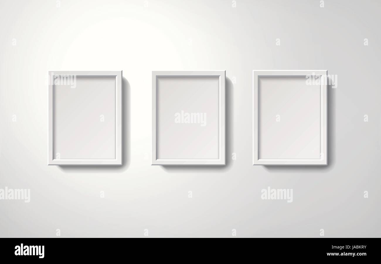 Blank white picture frames collection in an orderly way hanging on ...