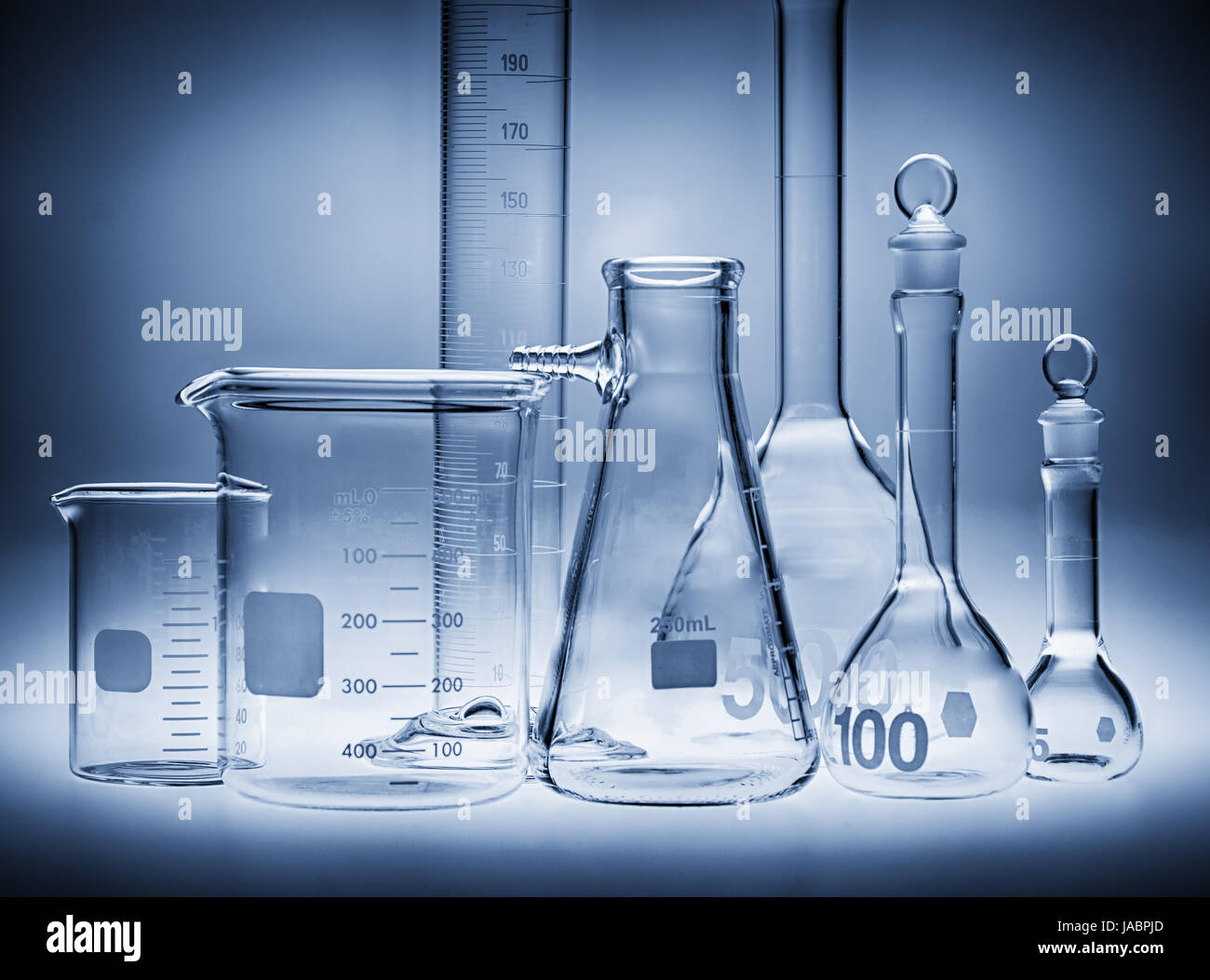 Glassware and beakers used in biology labs - Stock Image
