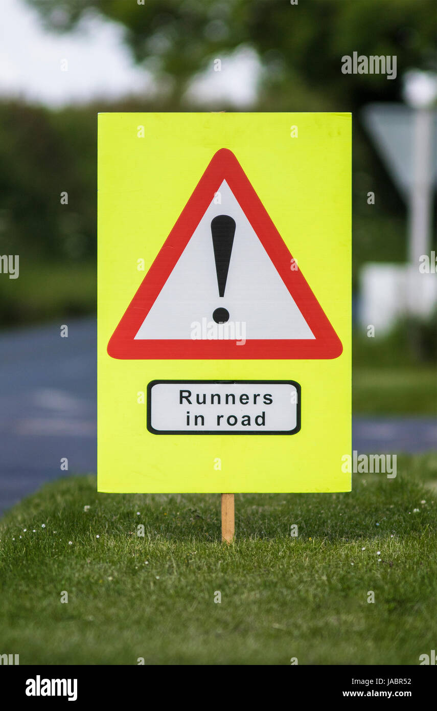 Quenington , UK - JUNE 4, 2017: Warning sign, runners in road in the village of Quenington, Gloucestershire in the - Stock Image