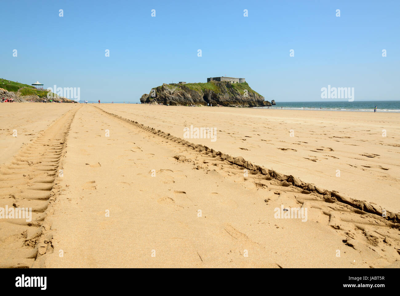 Tractor tyre marks on south beach, Tenby  Central is St Catherine's