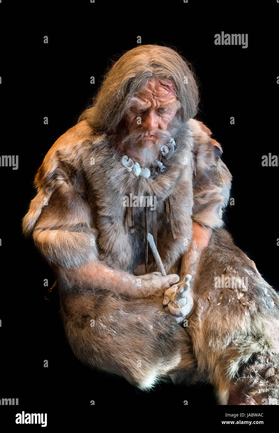 Waxwork of a Late Stone Age (Upper Paleolithic) Man c.30,000 BC, Neues Museum, Berlin, Germany - Stock Image