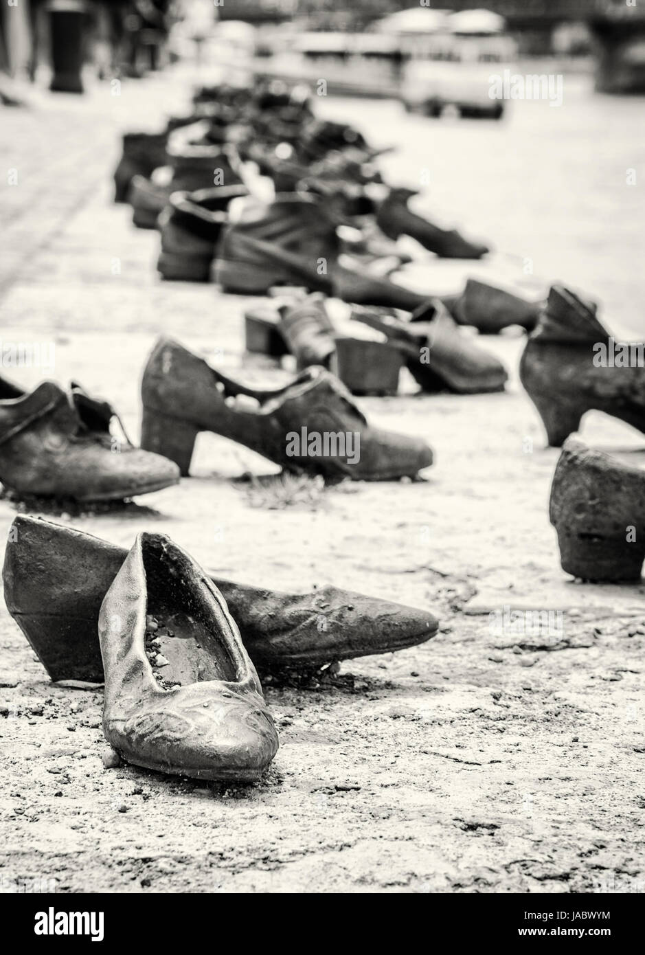 Shoes monument on the Danube bank is a memorial in Budapest, Hungary. Place of reverence. Symbolic object. Black - Stock Image