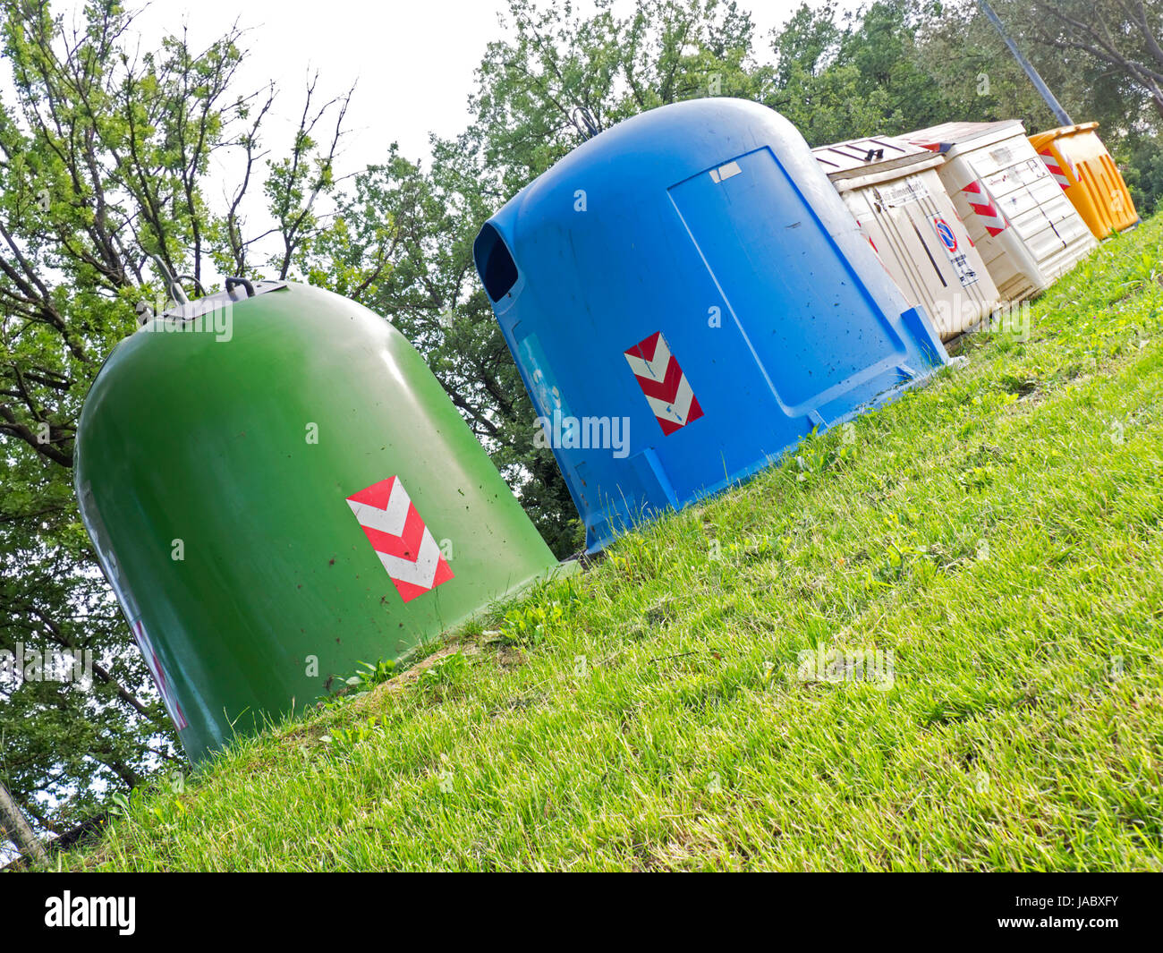 differentiated waste collection on the  green lawn - Stock Image