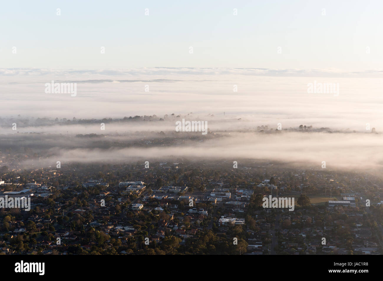 Fogs in the urban sky. - Stock Image