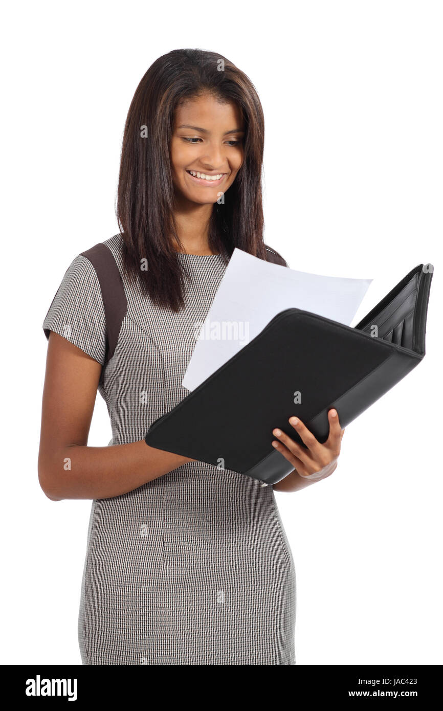 Beautiful african american businesswoman reading a report isolated on a white background Stock Photo
