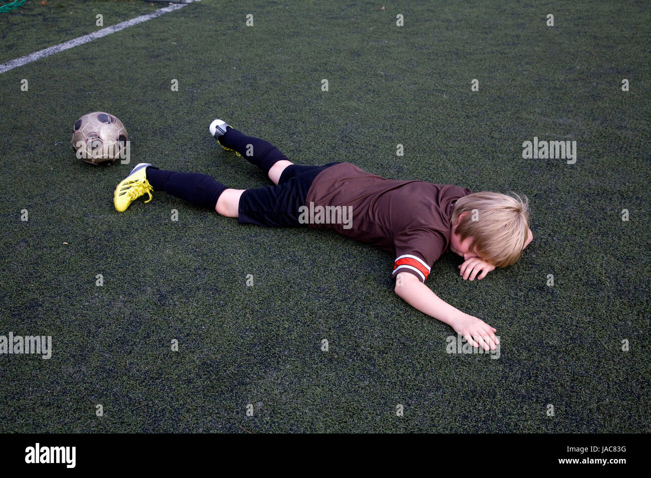 young after football game - Stock Image