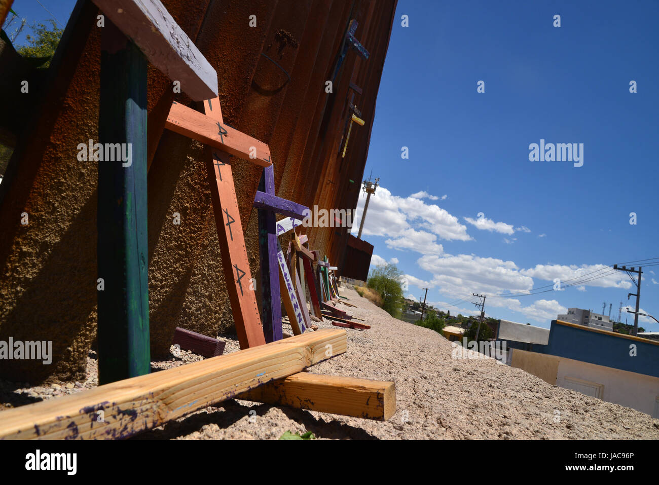 A wall indicates the international border with Nogales, Arizona, USA, as seen from Nogales, Sonora, Mexico. - Stock Image