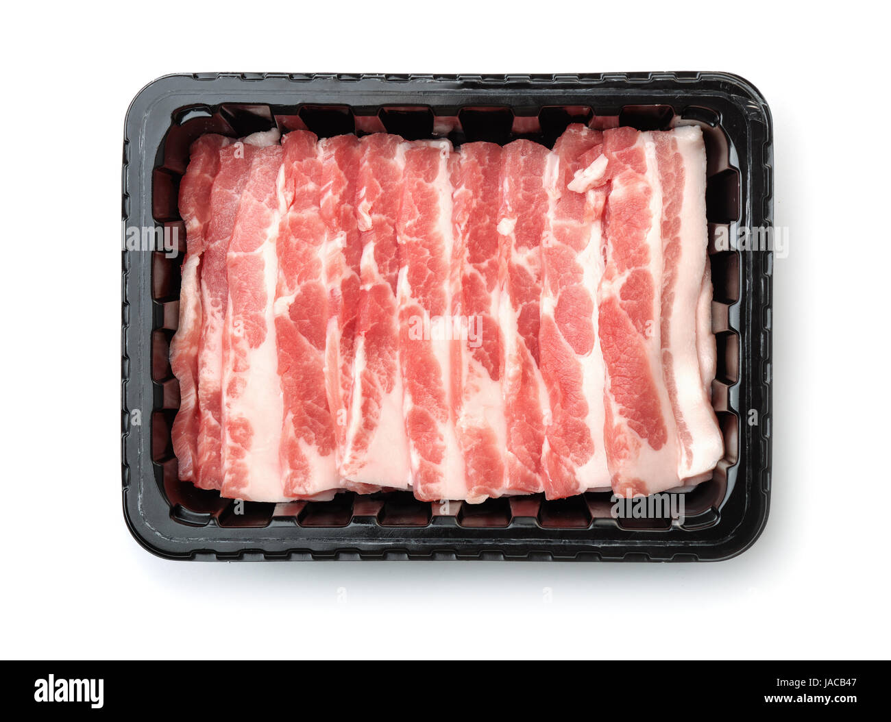 Top view of plastic disposable tray with raw sliced bacon isolated on white - Stock Image