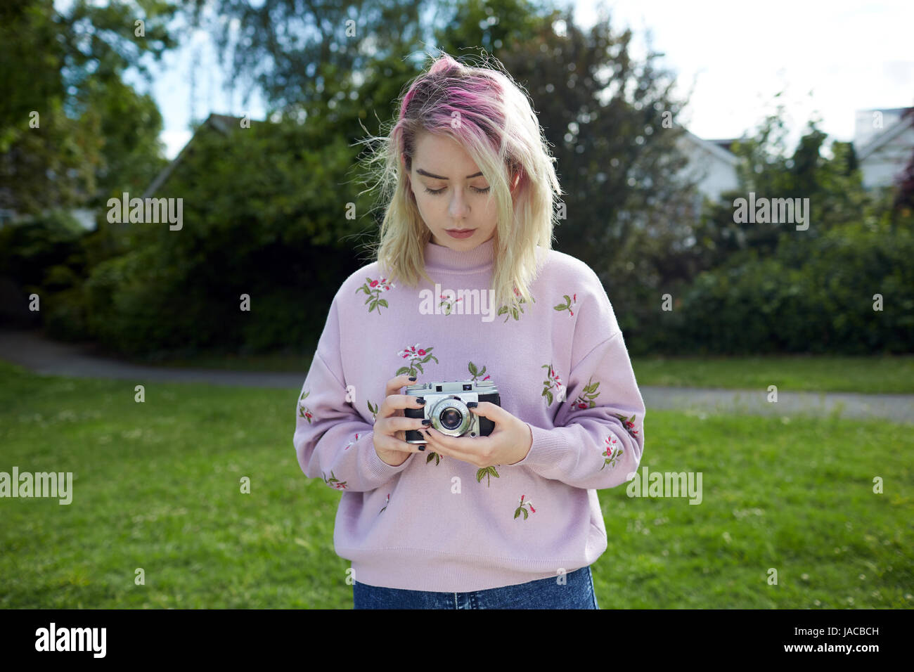 Young woman holding a 1950's Franka 35mm film camera - Stock Image