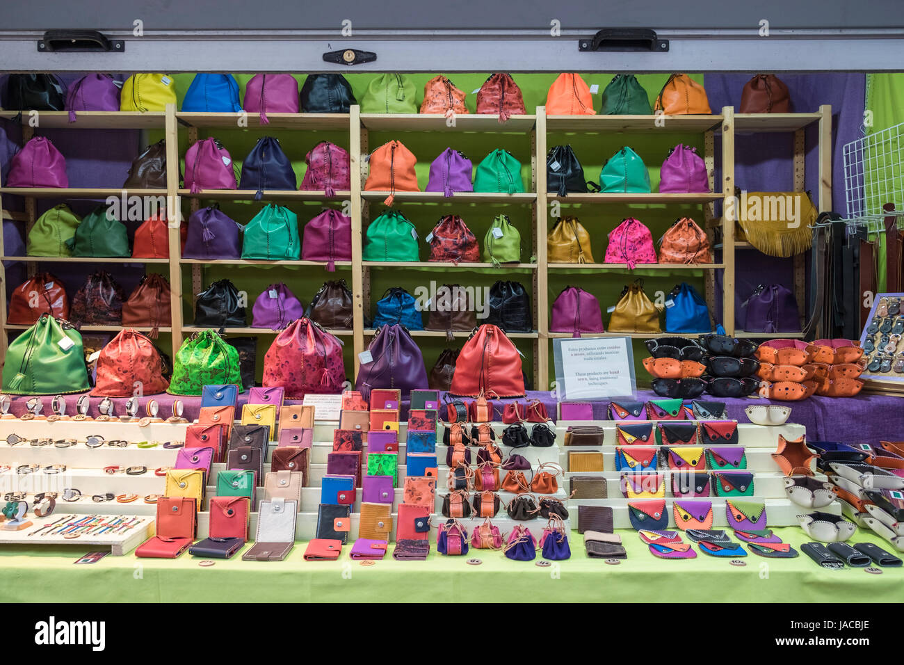 Colourful hand made artisan leather bags, wallets and purses on display and for sale at a street market stall, Madrid, - Stock Image