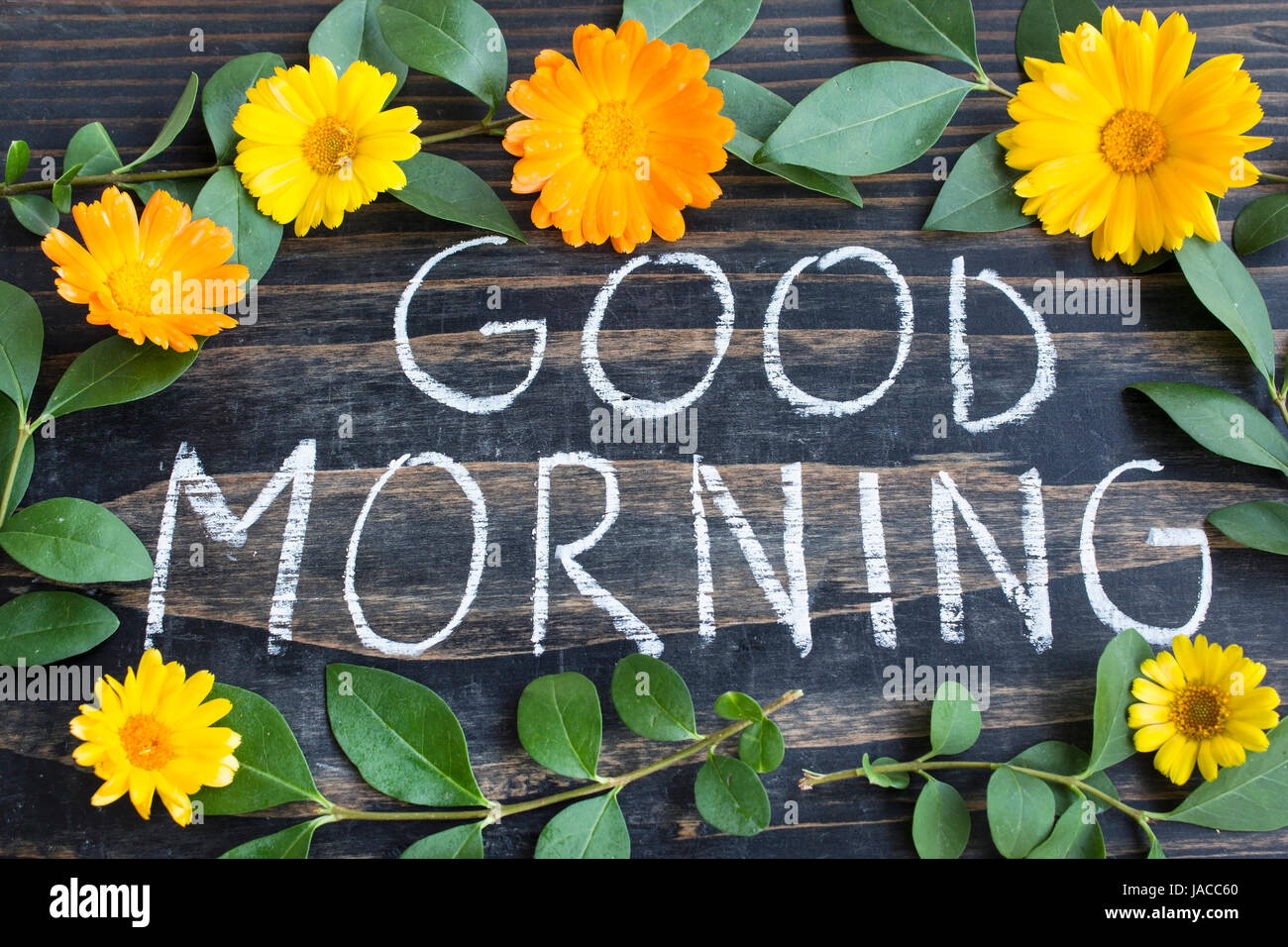 Words Good Morning With Leaves And Marigold Flowers On A Rustic