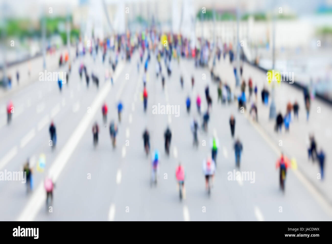 Abstract background of colored group of bicyclists in city center, bike marathon, blur effect, unrecognizable faces. - Stock Image