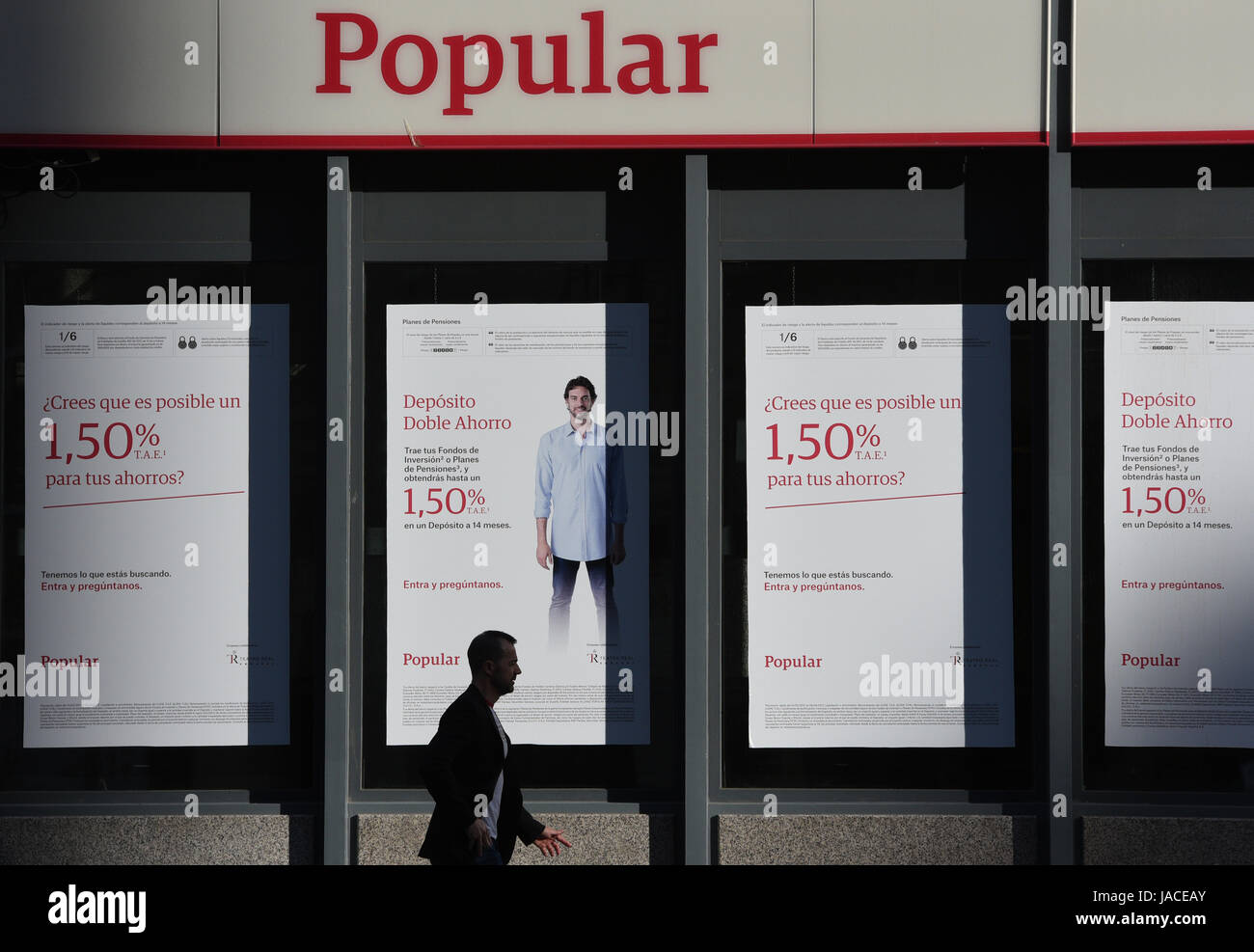 Madrid, Spain. 05th June, 2017. A man walks past in front of branch of Popular Bank in Madrid. Shares in Banco Popular - Stock Image