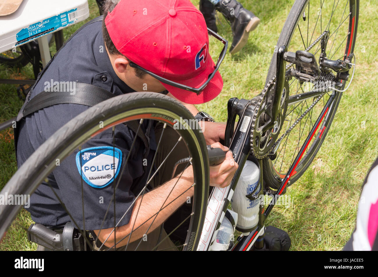 Montreal, Canada - 4 June 2017: A police officer is engraving a bike with an ID number at Park Jeanne to reduce - Stock Image