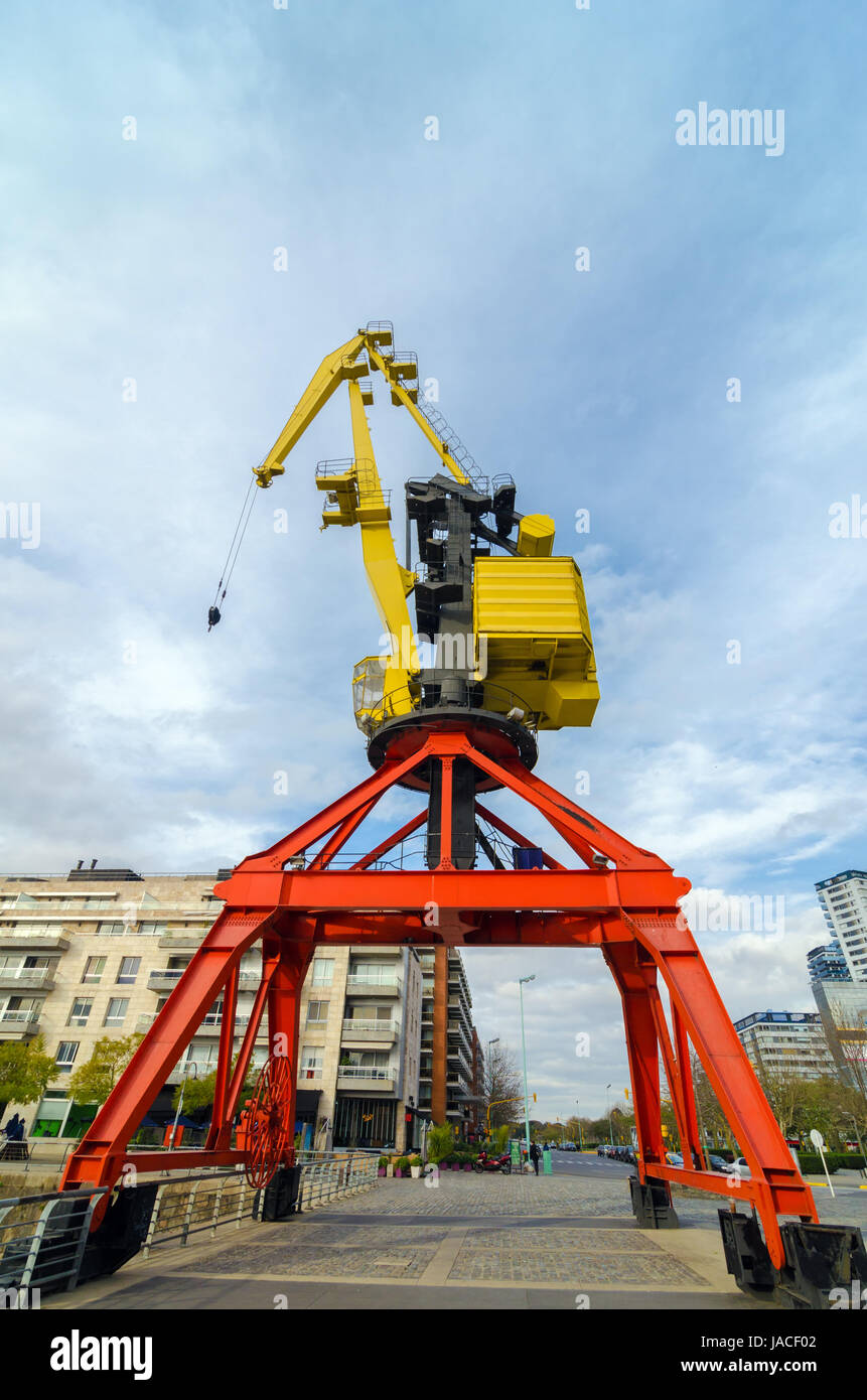 A tall no longer used red and yellow crane in Buenos Aires - Stock Image