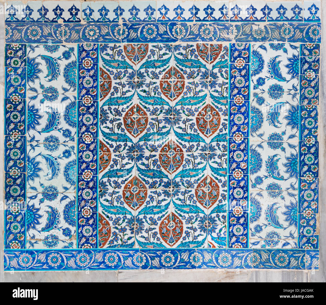 Old ceramic wall tiles with floral blue pattern in an exterior wall ...