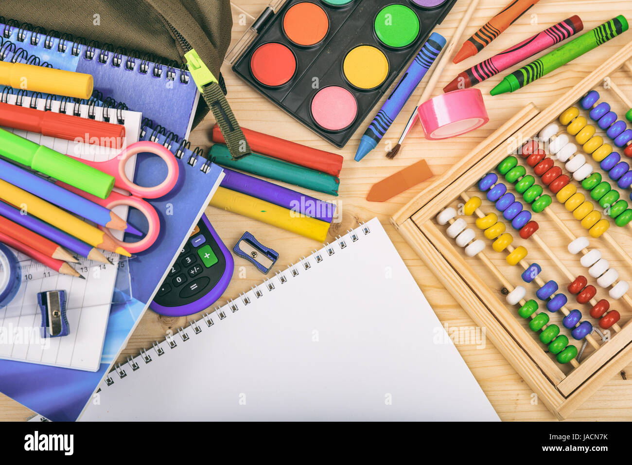 Variety of school supplies on wooden background Stock Photo