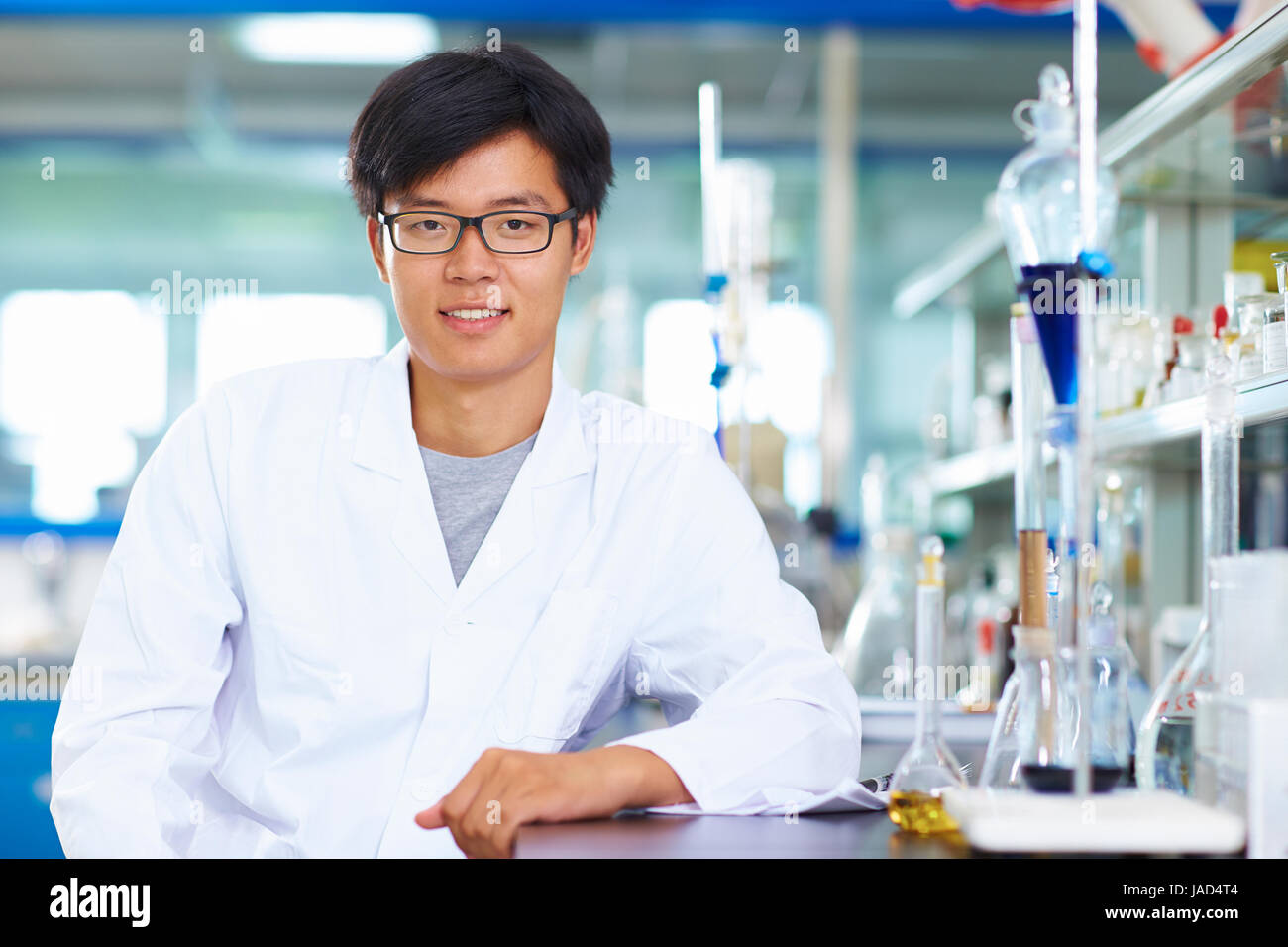 One male Chinese Laboratory scientist working at lab with test tubes - Stock Image