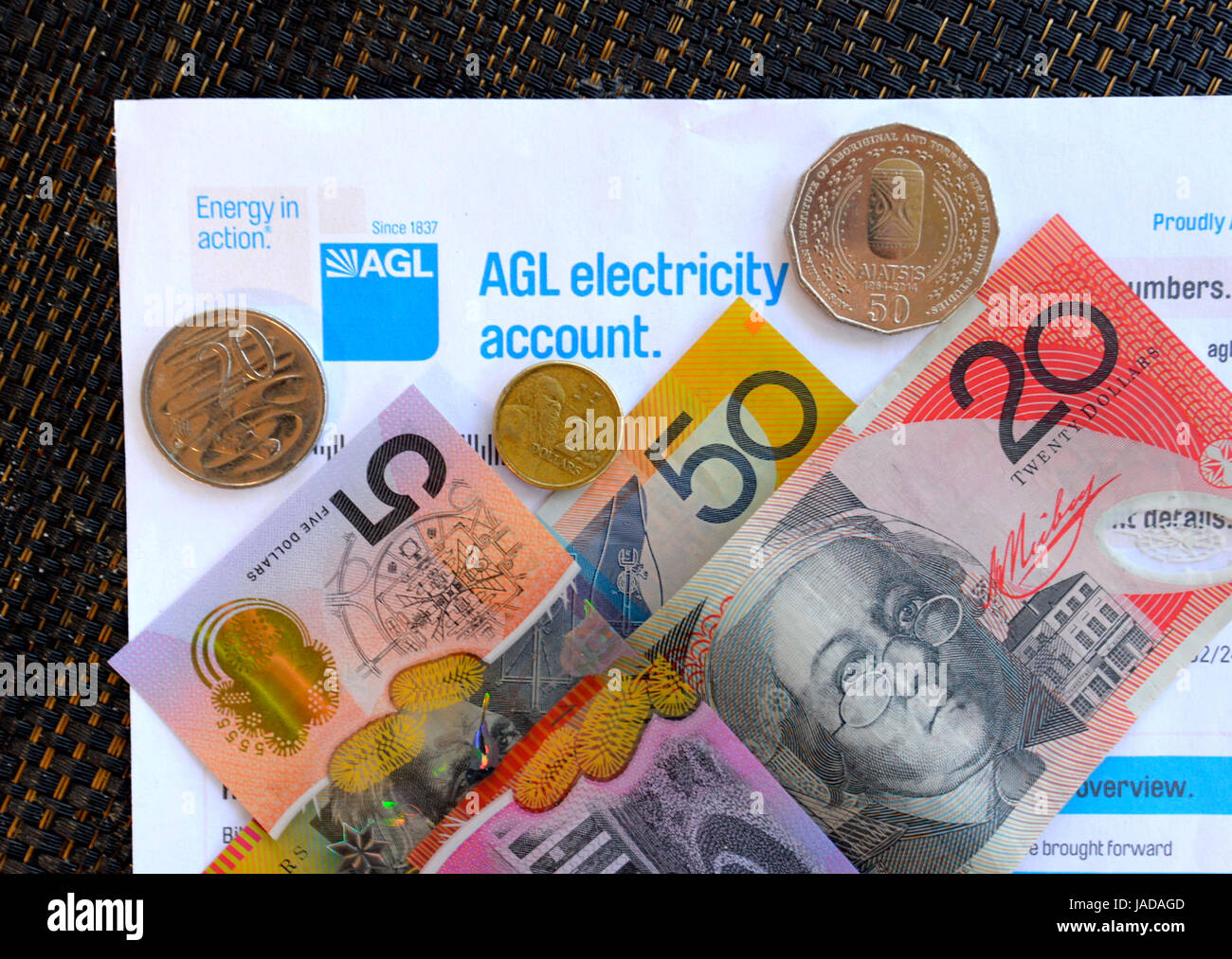 Paying an electricity bill with Australian Currency, Australian Dollars, AUD, Australia - Stock Image
