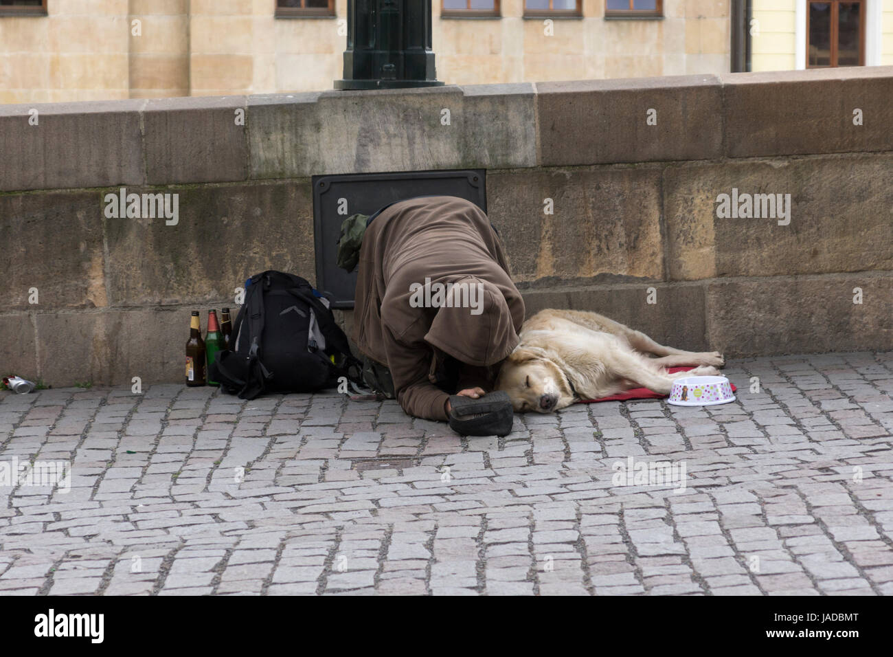 A beggar and his dog on the approach to Charles Bridge, Prague, Czech Republic - Stock Image