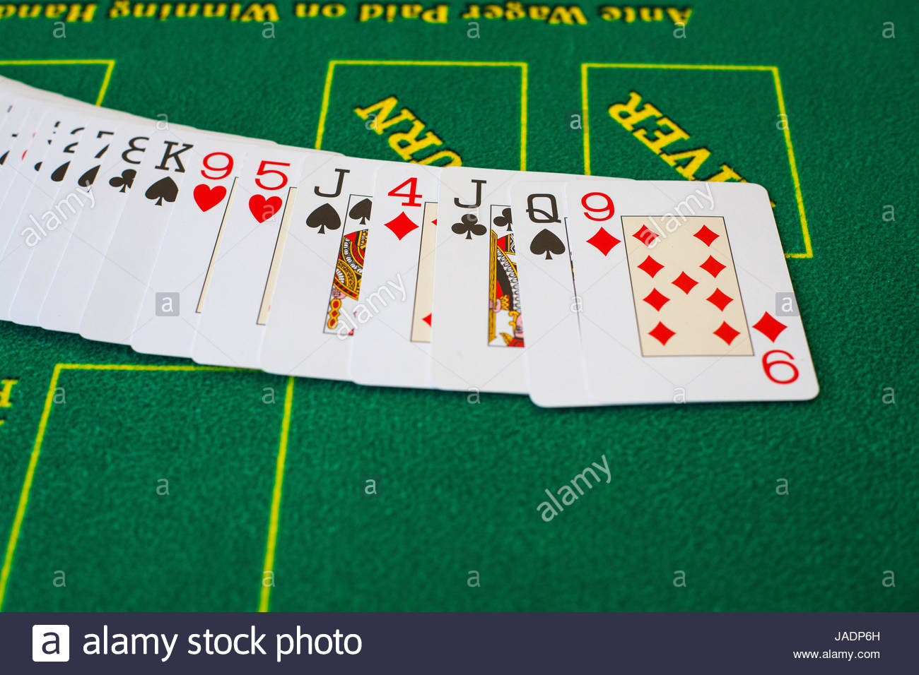 French cards for Texas hold 'em ion casino table - Stock Image