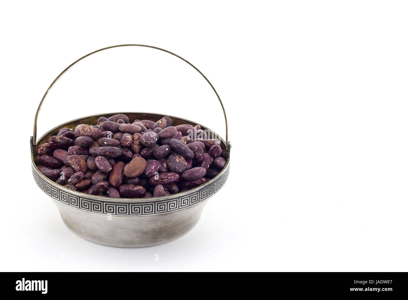 Red beans in antique silver bowl isolated on white background Stock Photo
