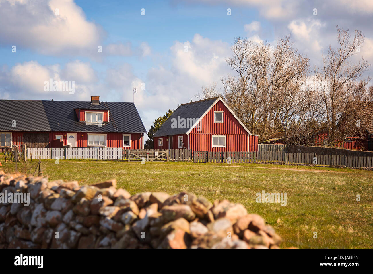 Image of typical swedish red house, in rural locaton. - Stock Image
