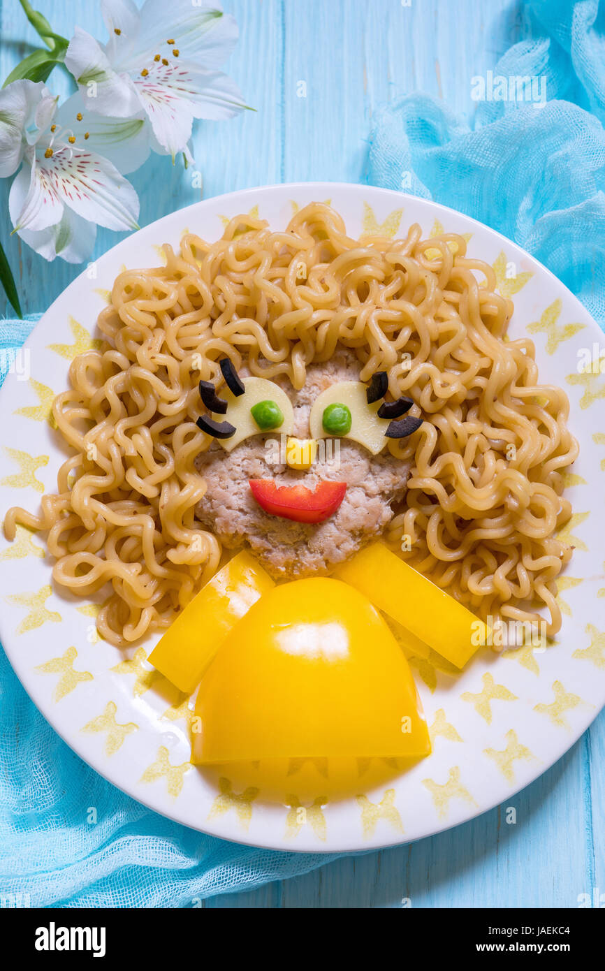 Funny Girl Food Face with Cutlet, Pasta noodles and Vegetables - Stock Image