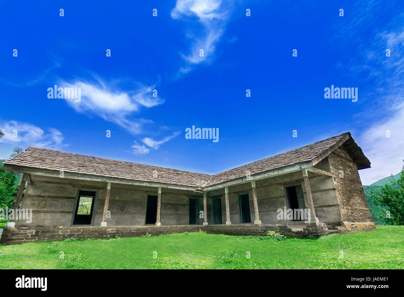 An old abandoned wooden house in the interior town of Himachal Pradesh called Janjehli, India - Stock Image