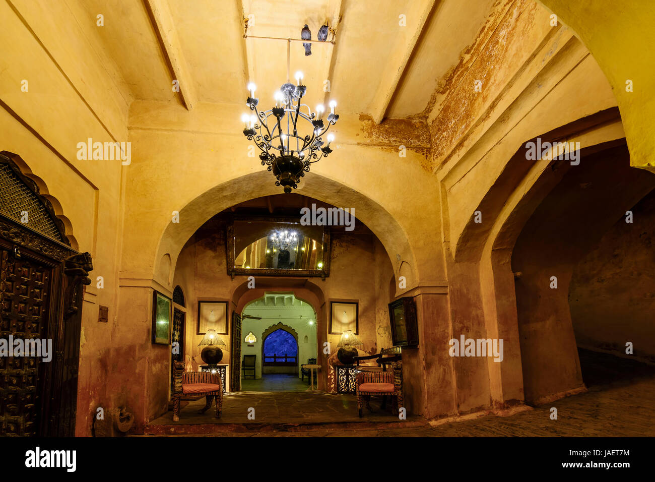 The ostentatious interiors of a historic Rajputana castle in Rajasthan, India - Stock Image