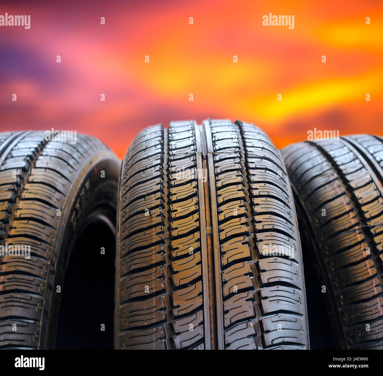 Set of tires against the evening sunset. - Stock Image