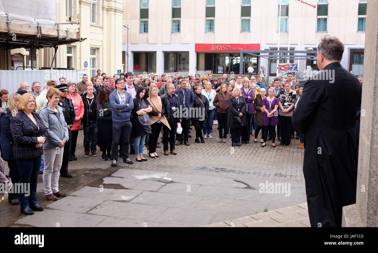 Brighton, UK. 6th June, 2017. Staff from Brighton Town Hall and members of the public join in a minutes silence - Stock Image