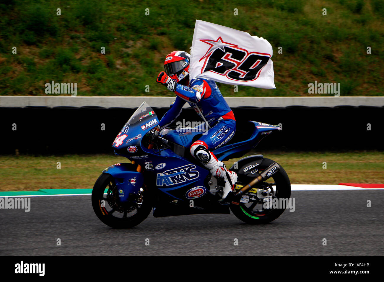 Florence, Italy. 04th June, 2017. Mattia Pasini pays tribute to Nicky Hayden whilst celebrating victory at the 2017 - Stock Image
