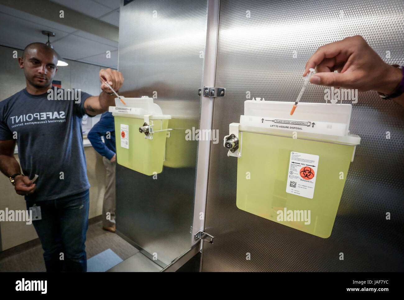 (170606) -- VANCOUVER, June 6, 2017 (Xinhua) -- A health authority staff member showcases a syringe disposal box - Stock Image