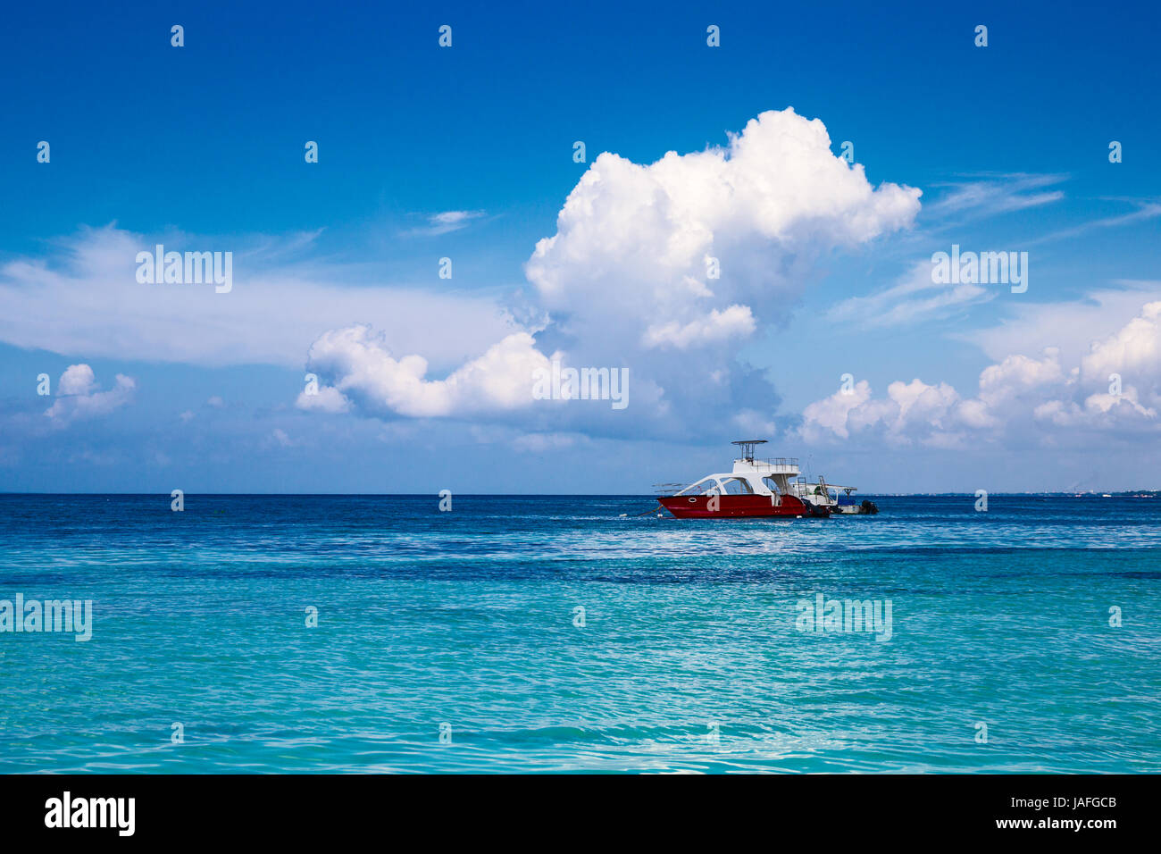 Boats in the Caribbean. A saturated blue sky, clouds and the sea. Dominican Republic - Stock Image