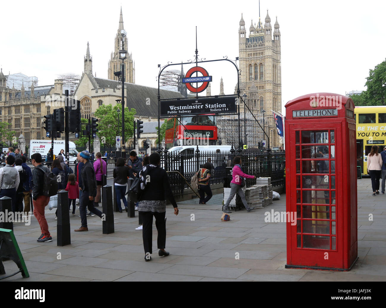 June 5, 2017 - Entrance to Westminster Underground station showing a famous London Red Telephone box - Stock Image